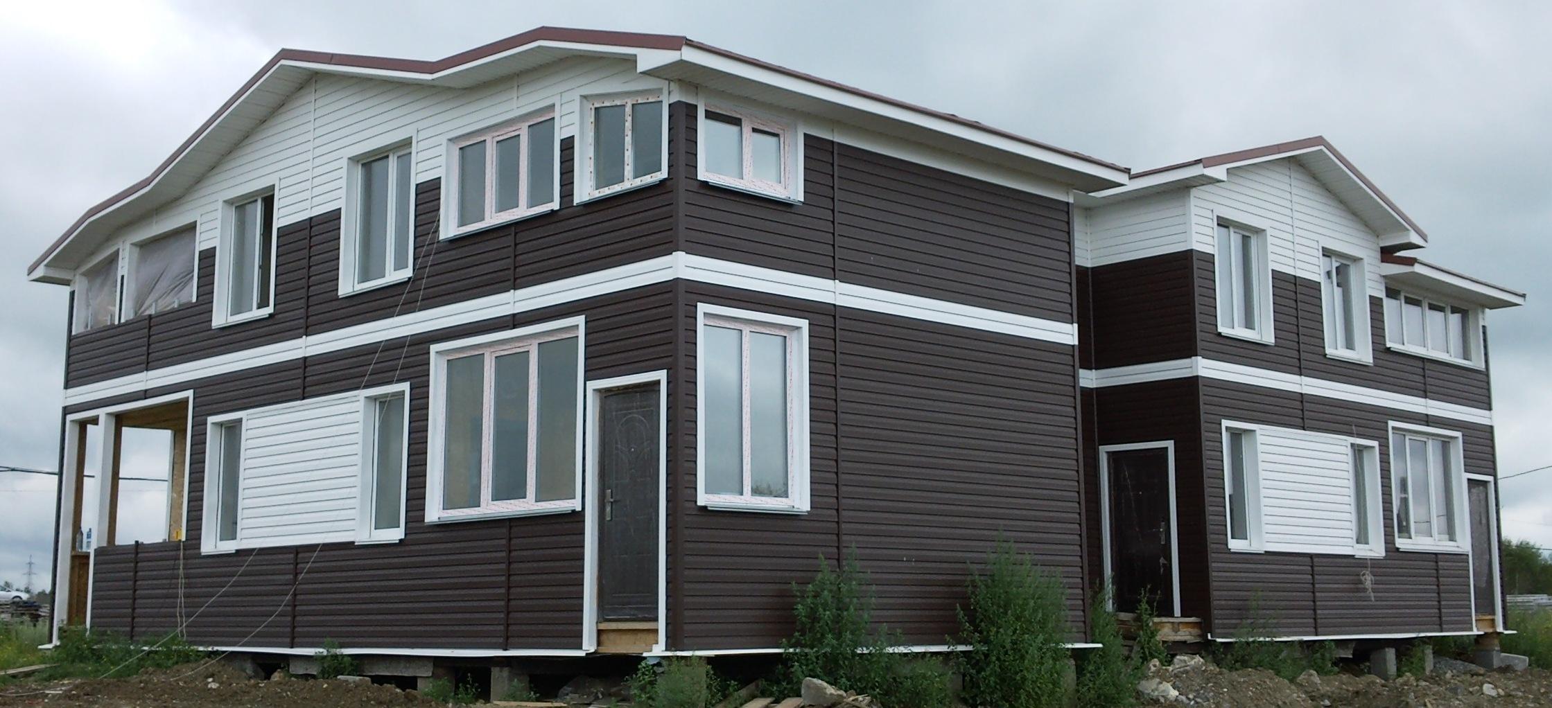 Дом с отделкой фасада виниловым сайдингом