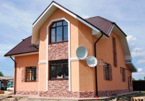 Отделка фасада дома декоративной штукатуркой