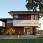 Как выглядит фасад с применением плоской крышей