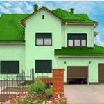 Красивый дом с зеленым фасадом