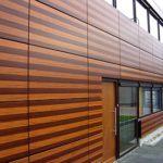 Оригинальные панели для фасада оранжевого цвета