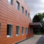 Панели вентилируемого типа для фасада оранжевого цвета