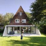 Стильный фид дома с практичным треугольным фасадом