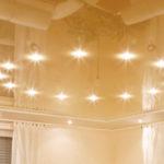 Какие светильники опасны для натяжного потолка