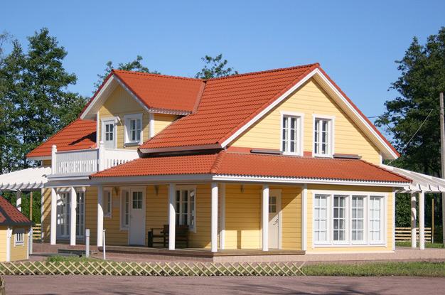Фасады домов с мансардой