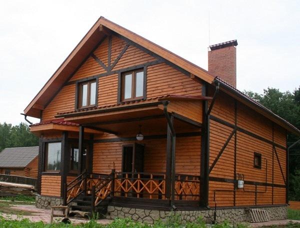 Отделка фасада деревянного дома