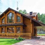 Частный дом с фасадом с треугольными окнами