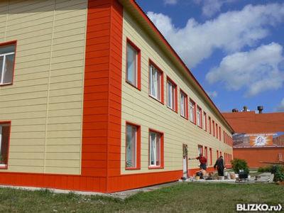 Фасадные панели для здания в орнжевом оформлении