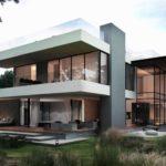 Красивый дом с фасадом с большими окнами