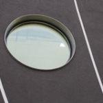 Пример красивого фасада с круглыми окнами