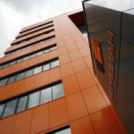 Современные фасадные панели оранжевого цвета