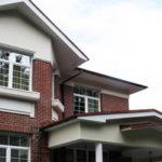 Облицовка фасада из клинкерной плитки под кирпич красного цвета