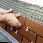 Технология укладки керамической фасадной плитки красного цвета